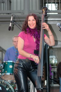 Leslie jamming on her upright electric bass by BSX